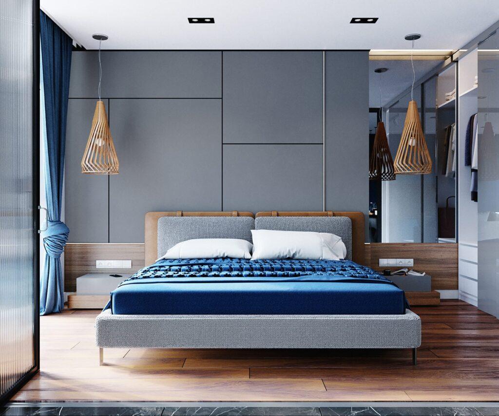 Đèn, sàn gỗ góp phần làm ấm khu vực ngủ nghỉ của căn hộ màu xanh dương