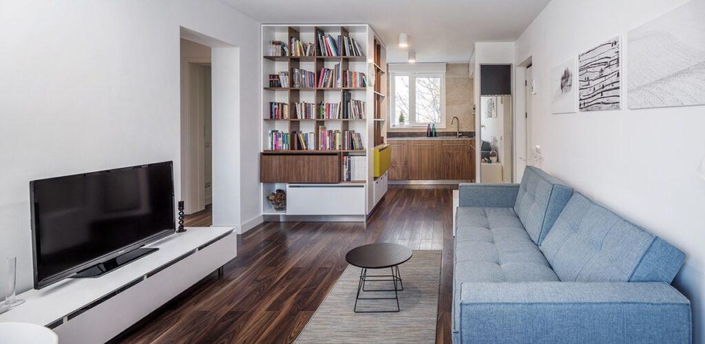 Sử dụng giá sách ngăn 2 không gian khác nhau sẽ khiến căn hộ bạn quyến rũ hơn