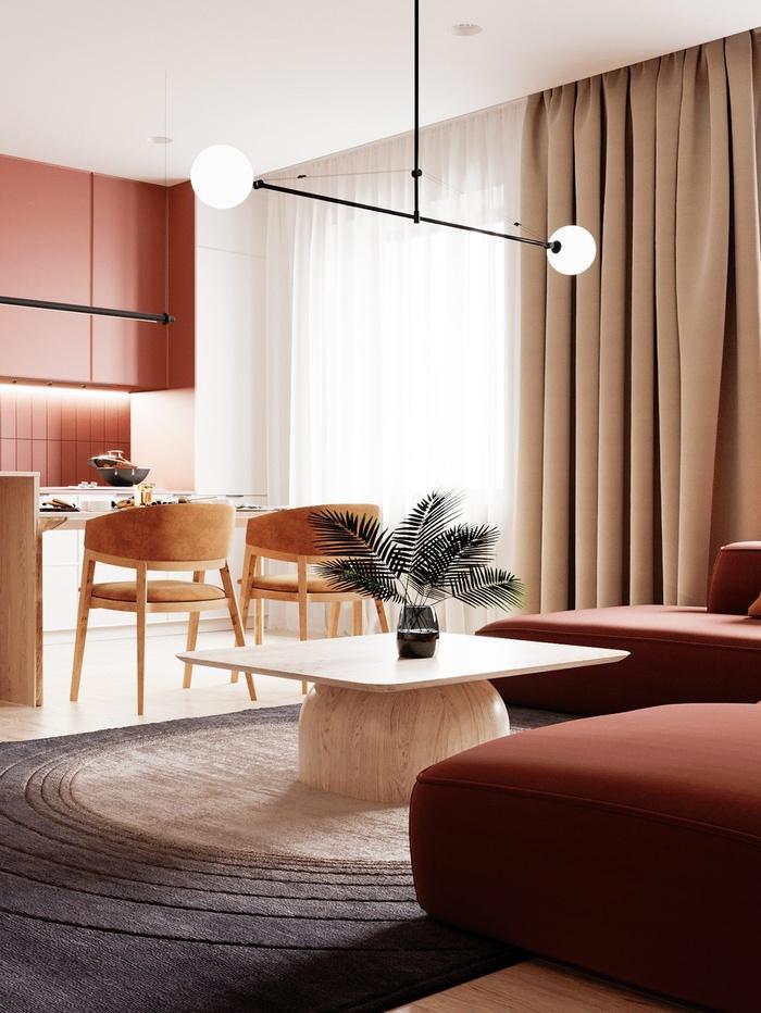 Căn hộ chung cư cùng phòng bếp có tone màu cam đỏ