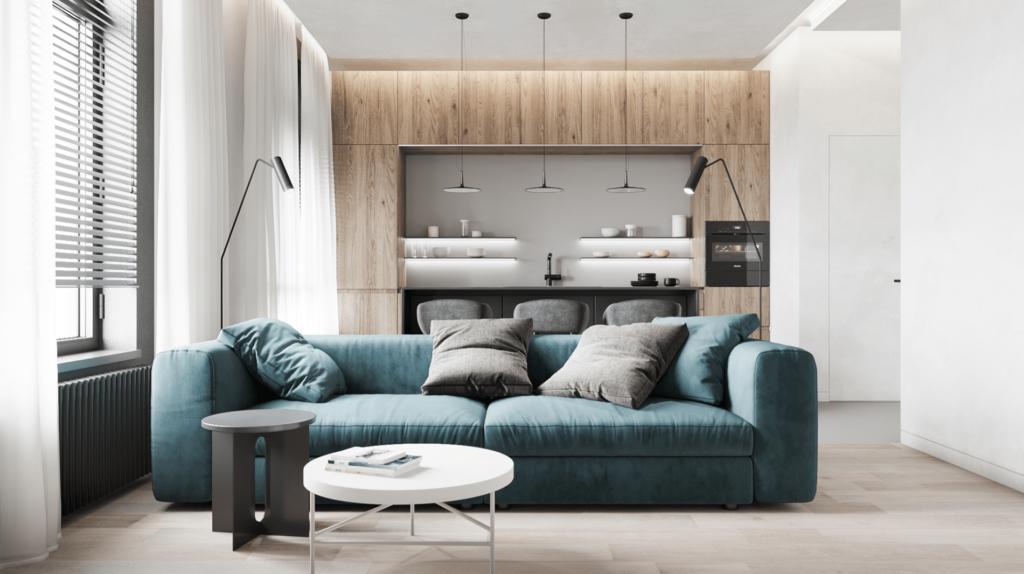 Với tone màu trắng làm chủ đạo, chị Nhung đã chọn bộ sofa xanh làm điểm nhấn cho căn phòng khách