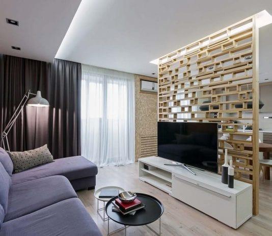Bạn cũng có thể dùng lam gỗ để làm vách ngăn giữa phòng khách và phòng bếp để tiết kiệm không gian.