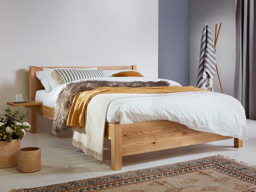 Giường ngủ gỗ tần bì thích hợp sử dụng trong không gian được thiết kế theo phong cách hiện đại. (Ảnh sưu tầm)
